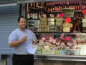 Chef Craig tasting in Barcelona cheese stand.